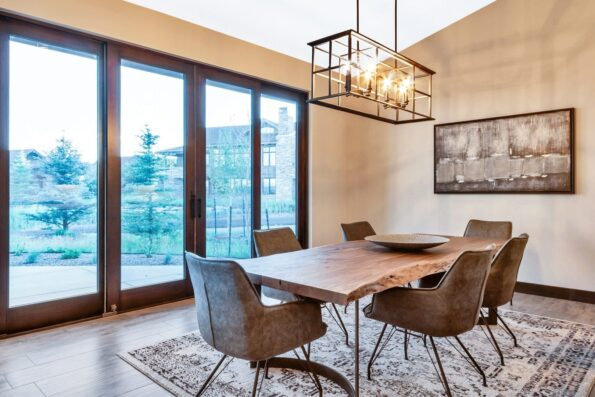 A dining area with a wooden table and six chairs