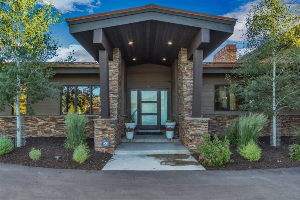An entry way of a home with glass doors