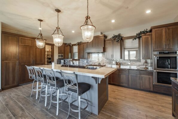A kitchen with two ovens and a huge sink