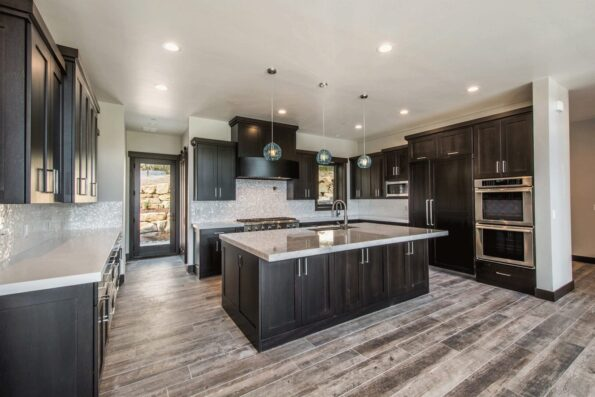 A kitchen with white countertops and wooden cabinets