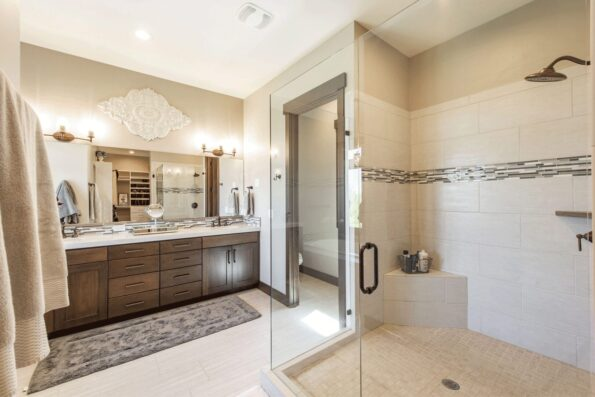 A neutral-colored bathroom with wooden cabinets