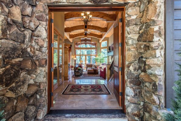 A home entrance with stone walls
