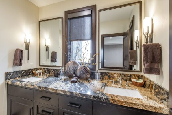 A bathroom with two sinks and mirrors