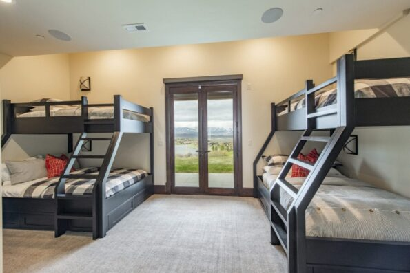 a bedroom with two double deck beds