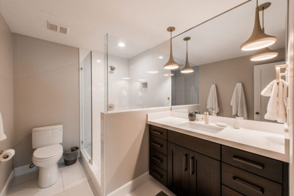 A white bathroom with towels