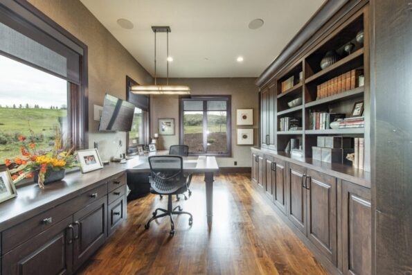 A home office with wide windows