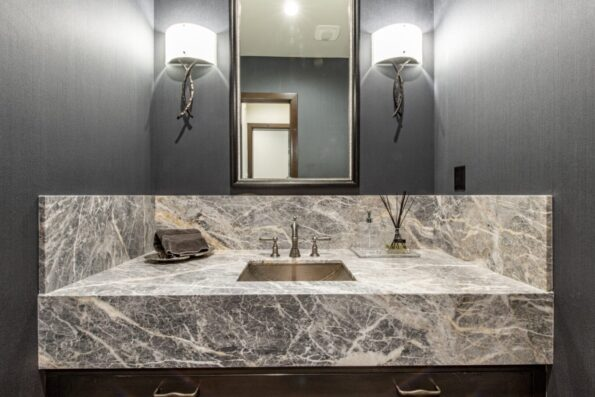 a bathroom sink with granite countertop