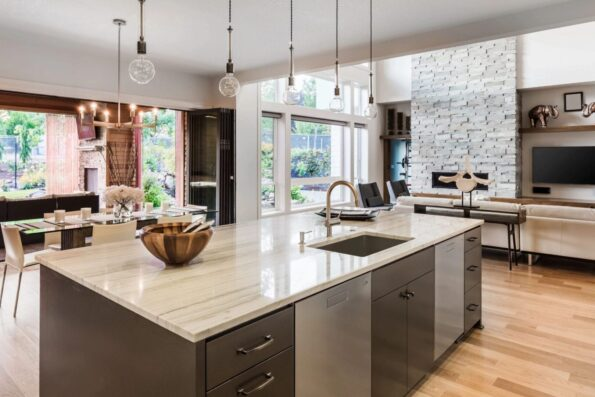 A kitchen overlooking the dining and living area